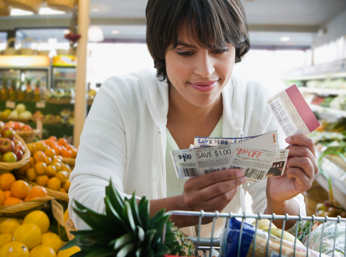 Woman Grocery Shopping with Coupons